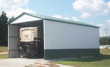 <p>Enclosed RV Garage With<br /> Vertical Roof and Wall Sheeting</p>