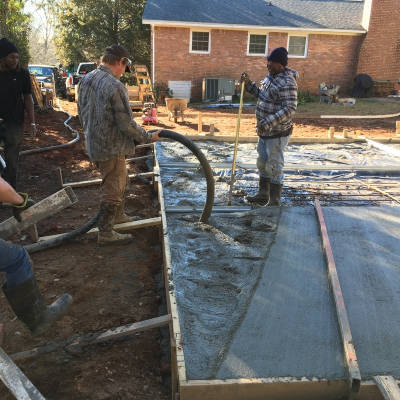 pouring concrete slab steel garage