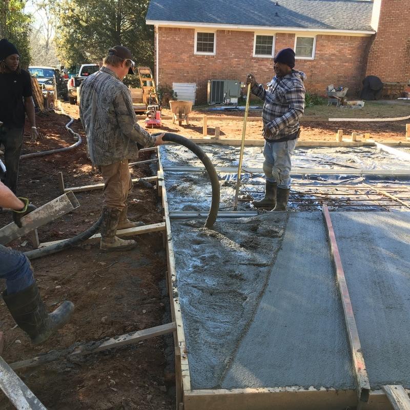 pouring concrete slab steel garage