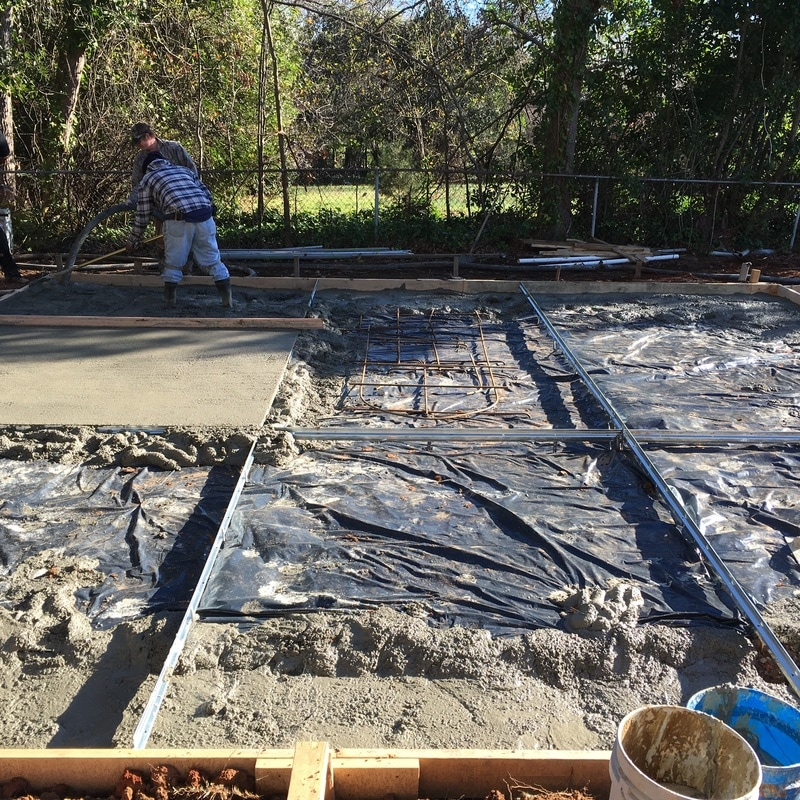 Steel garage building kit concrete footing slab south for How to pour a concrete slab for a garage